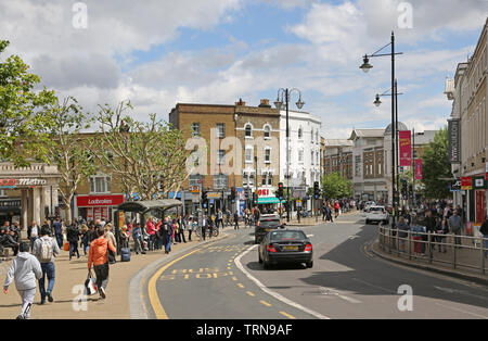 Wimbledon town centre, southwest London crowded with shoppers on a busy, summer Saturday. View east along Wimbledon Broadway. - Stock Photo