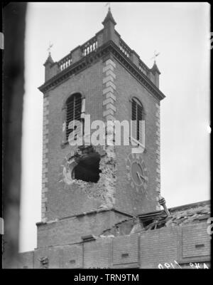 St John's Church, High Street, Deritend, Birmingham, West Midlands, 1941. A view from the window of the Church Institute showing air raid damage to the tower of St John's Church. This building of 1735 replaced an earlier chapel of 1380. By 1939 it had ceased to be used for worship and its fate was sealed when it was damaged by enemy bombing in 1940. It was demolished in 1947. The Bull Ring Trading Estate now occupies the site. - Stock Photo