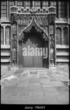 Door in an unidentified church, possibly in or near Long Melford, Suffolk, c1955-c1980. A detailed view of the door, showing an ogee head, two niches either side and a parapet with polygonal ends, and with carved arcading and pierced design throughout. The photographer's handlist suggests that this door is in Long Melford. - Stock Photo