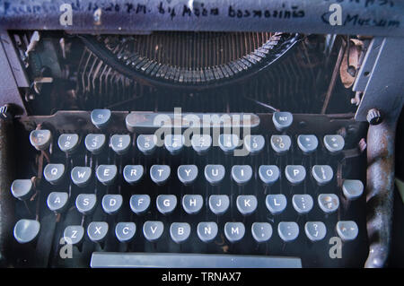 An antique typewriter was once an used when this museum was still a hospital devoted to the cure of leprosy and the care for those who had the disease. - Stock Photo