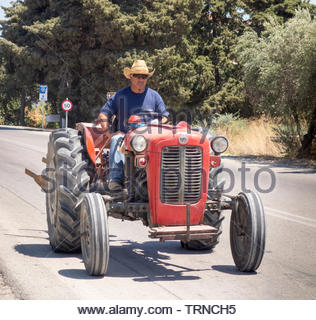 Europe, Greece, 2018: View Of Greek Farmer Driving Tractor - Stock Photo