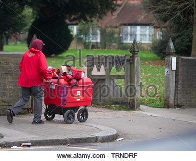 Europe, Uk, North London, Tottenham / Edmonton Area, 2018: View Of British Postman Delivering Mail by Pushcart - Stock Photo
