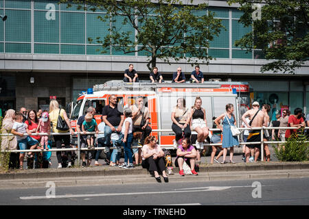 Berlin, Germany - june 2019: People /Spectators on side of the road watching Karneval der Kulturen (Carnival of Cultures) in Berlin - Stock Photo