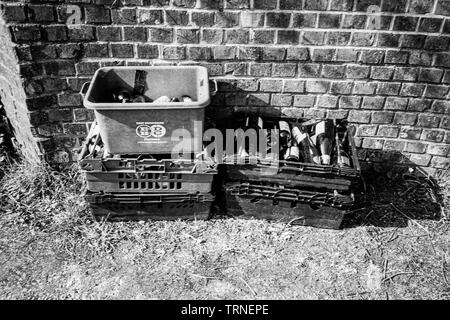 Crates of glass bottles out for recycling collection, Hattingley, Medstead, Alton, Hampshire, England, United Kingdom. - Stock Photo