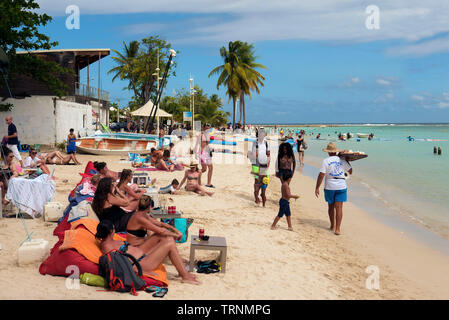 Sunbathers on Saint Anne beach in Basse-Terre Guadeloupe - Stock Photo