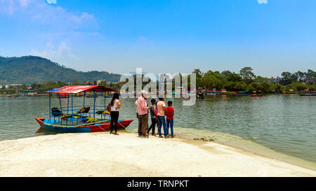 People Waiting For Boats in Tal Barahi Temple Boat Bay view from Tal Barahi Temple Pokhara Nepal. 21 May 2019. - Stock Photo