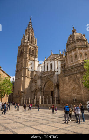 TOLEDO, SPAIN - April 26, 2019: People visiting the cathedral church of Toledo, Spain - Stock Photo