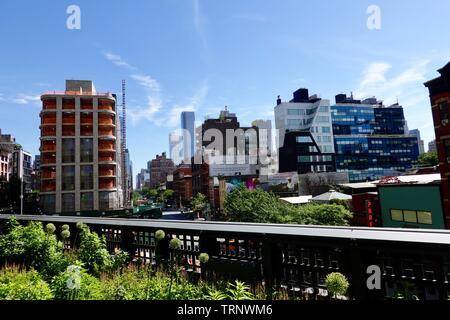 Skyline as seen from the public park, converted rail linear park, the High Line, New York, NY, USA