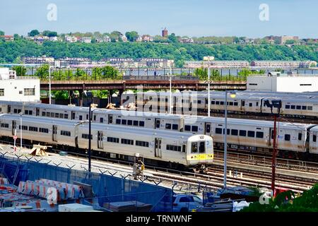 Long Island Railroad trains parked in the Hudson Train Yards, overlooking the Hudson River, New York, NY, USA - Stock Photo