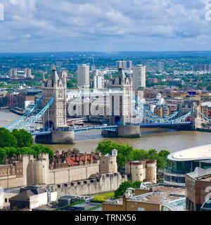 London, UK - 7th June 2019: Tower Bridge and a view of of the city of London from the rooftop garden at 120 Fenchurch Street. - Stock Photo