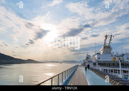 Norwegian Fjords Cruise. Dawn view of town and port of Ålesund from deck of the TUI cruise ship Marella Explorer, Møre og Romsdal, Sunnmøre, Norway - Stock Photo