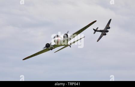 Avro C19 Anson flying in formation with the Bristol Blenheim Mk1 at the 2019 Shuttleworth Flying Festival - Stock Photo
