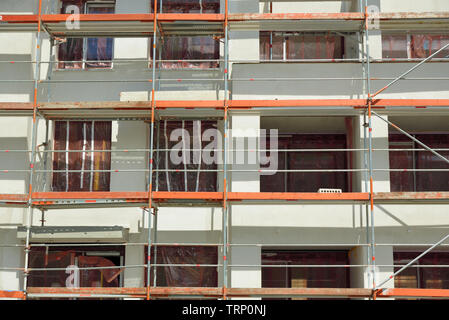 Construction site with scaffolding of a residential building in progress - Stock Photo