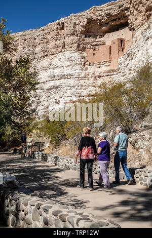 Visitors below Montezuma Castle cliff dwelling, Montezuma Castle National Monument, Arizona USA - Stock Photo