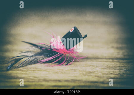 Fly fishing lure close-up in retro style - Stock Photo