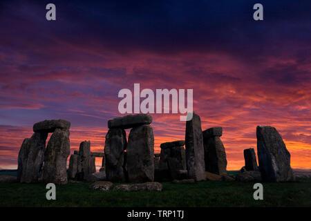 Amesbury,ancient,Solstice,Sunrise,sun,beams,Neolithic, Stone, Circle, Stonehenge, Wiltshire, England, UK, - Stock Photo