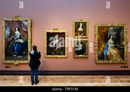 Visitor looking at paintings inside Scottish National Portrait Gallery in Edinburgh, Scotland , Uk - Stock Photo