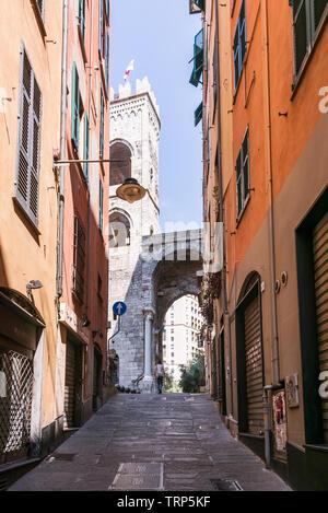 Vico delle Carabaghe street leading to one of Genoa gates - Porta Soprana. Summer day on Italian street. - Stock Photo