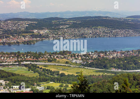 Zurich, Switzerland - June 5, 2019: Lake Zurich as seen from Mt. Uetliberg. The Uetliberg is a mountain rising to 870 m and offering a panoramic view - Stock Photo