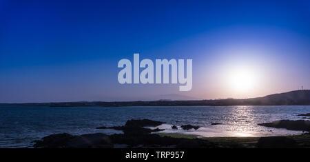 Sun set along the beach to Seopjikoji, Jeju Island, South Korea. - Stock Photo