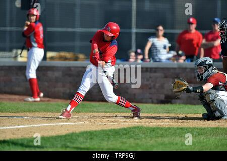 The ball coming off the bat as the hitter doubled to drive in two runs. USA - Stock Photo