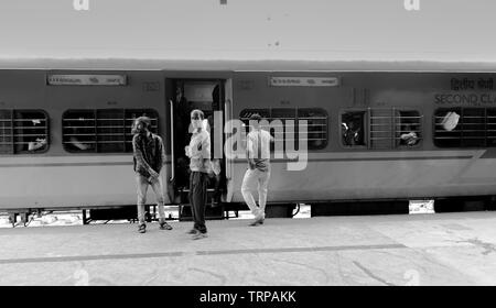 BANGALORE INDIA June 3, 2019 :Black and white Image of People outside the train waiting for the train movement. - Stock Photo