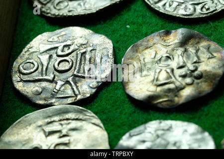 Set of vintage minted coins on a table with a green fleecy cloth - Stock Photo