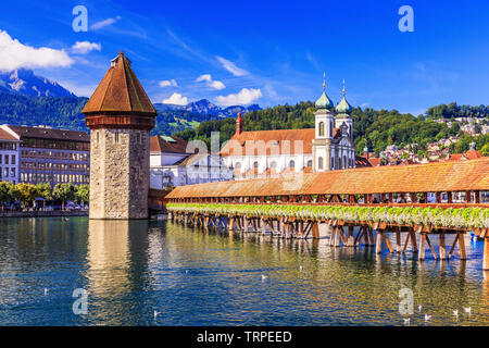 Lucerne, Switzerland. Historic city center with its famous Chapel Bridge.(Vierwaldstattersee) - Stock Photo