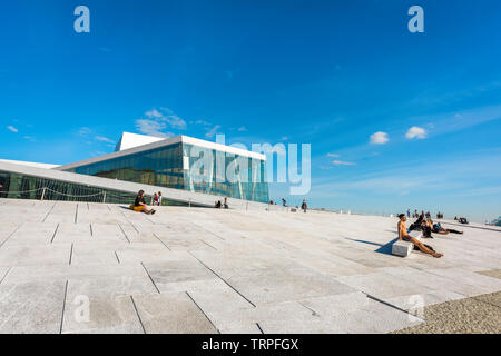 Opera House Oslo, view in summer of people sunbathing along the waterfront concourse of the Oslo Opera House, Norway. - Stock Photo