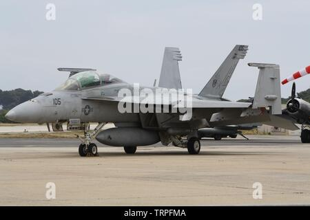 Boeing F/A-18F Super Hornet AC-105 from VFA-32 'Fighting Swordsmen' (crew pilot Derrick 'Probes' Dudash, operator Tim 'Awol' Henry) on the airfield Stock Photo