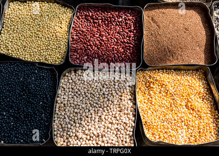 Organic dried beans, corn, mung bean, chickpeas on the farmers market. Healthy vegan food. - Stock Photo