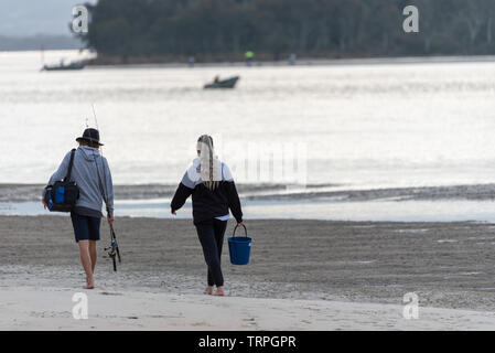 couple going to go  fishing together on an Australian inlet - Stock Photo