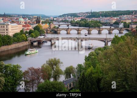 Prague bridges over Vltava River at dusk. Scenic view from Letna Hill, Czech Republic Stock Photo