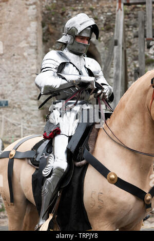 Close-up of a mounted Knight in full Armour  getting ready for an English Heritage Jousting Tournament at Dover Castle,  August 2018 - Stock Photo