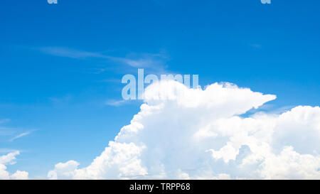 Beautiful blue sky and white cumulus clouds abstract background. Cloudscape background.  Blue sky and fluffy white clouds on sunny day. Nature weather - Stock Photo