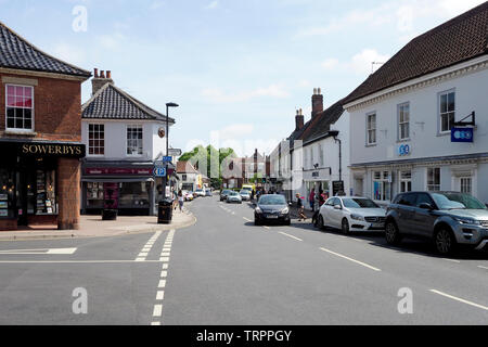 Quaint Georgian buildings in the North Norfolk market town of Holt, a thriving town attracting many tourists. - Stock Photo
