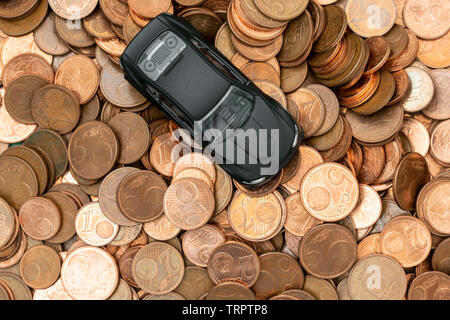 Car and money. Concept for buying, renting, insurance, fuel, service and repair costs.Top view - Stock Photo