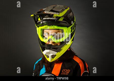 A portrait of a BMX rider wearing a helmet - Stock Photo