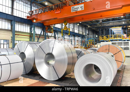 industrial plant for the production of sheet metal in a steel mill - storage of sheet rolls - Stock Photo