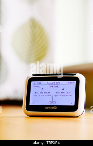 Smart Meter on cabinet showing energy readings - Stock Photo