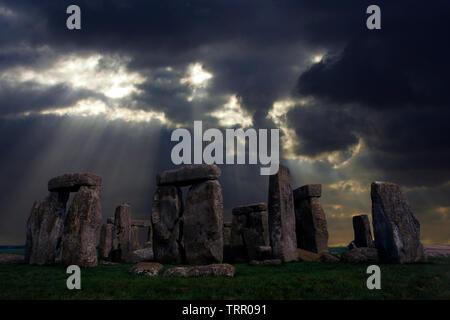 Amesbury, ancient,Solstice, sun,beams,storm,rain, dramatic,Neolithic, Stone, Circle, Stonehenge, Wiltshire, England, UK, - Stock Photo
