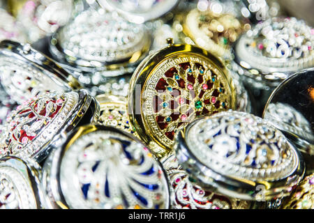 lots of pocket metal mirror pile background - Stock Photo