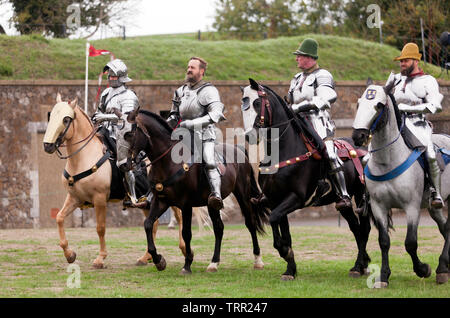 Four Knights in full Armour demonstrating their  Horse riding skills, during an  English Heritage Jousting Tournament at Dover Castle,  August 201 - Stock Photo