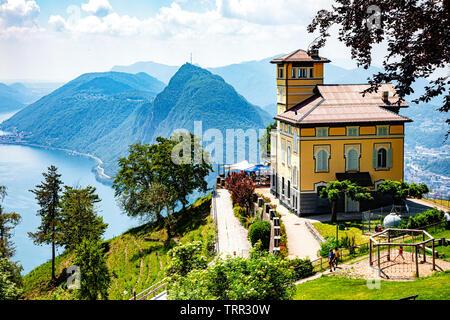 Mont Bre, Switzerland - June 08, 2019 View of Resturant Vetta over Lake Lugano - Stock Photo
