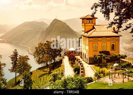 Mont Bre, Switzerland - June 08, 2019 Beautiful view of Resturant Vetta over Lake Lugano - Stock Photo