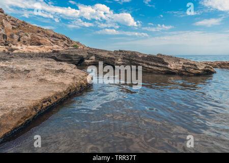 Rocky sea shore empty beach