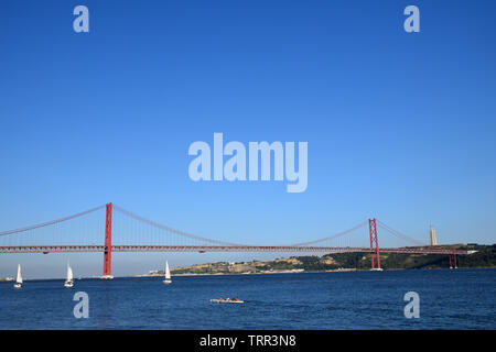 The Ponte 25 de Abril suspension bridge over Tagus River, Lisbon, Portugal, June 2019 - Stock Photo