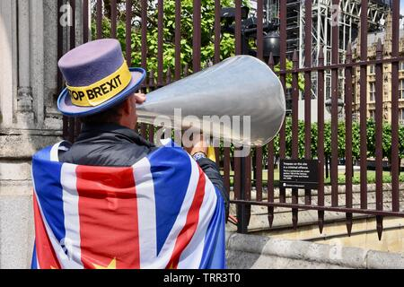 London, UK. 11th June, 2019.  Steve Bray SODEM activist urges the authorities to call in the sniffer dogs following the recent revelations of past drug taking by Tory Politicians. Houses of Parliament, Westminster, London. UK Credit: michael melia/Alamy Live News - Stock Photo