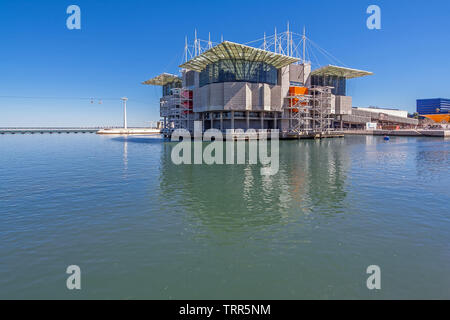 Lisbon, Portugal. Oceanario de Lisboa or Lisbon Oceanarium and olivais Dock, the second largest aquarium in the world and the biggest in Europe - Stock Photo