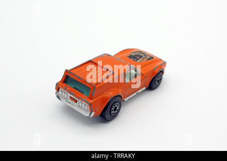 Vintage collectable orange toy car, isolated on white background, close-up - Stock Photo